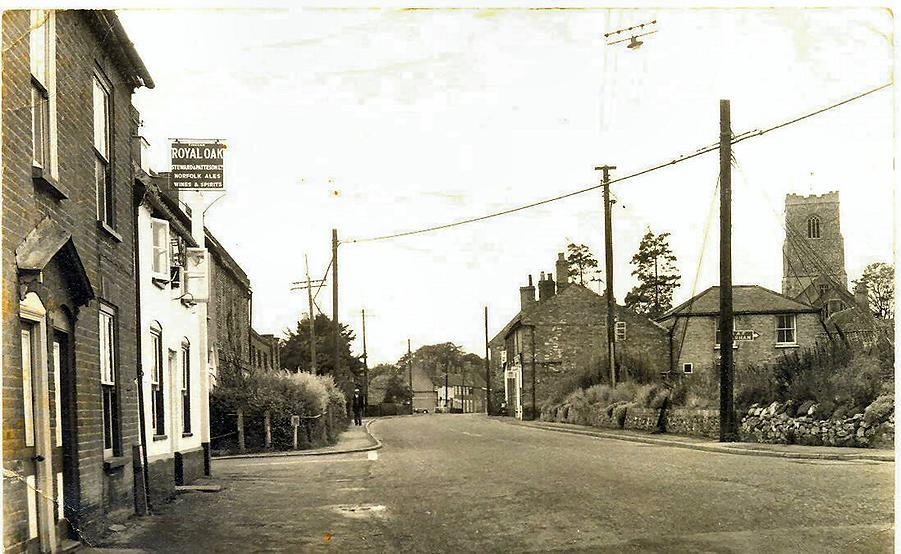 The Church can be seen in this old photograph taken outside the Royal Oak